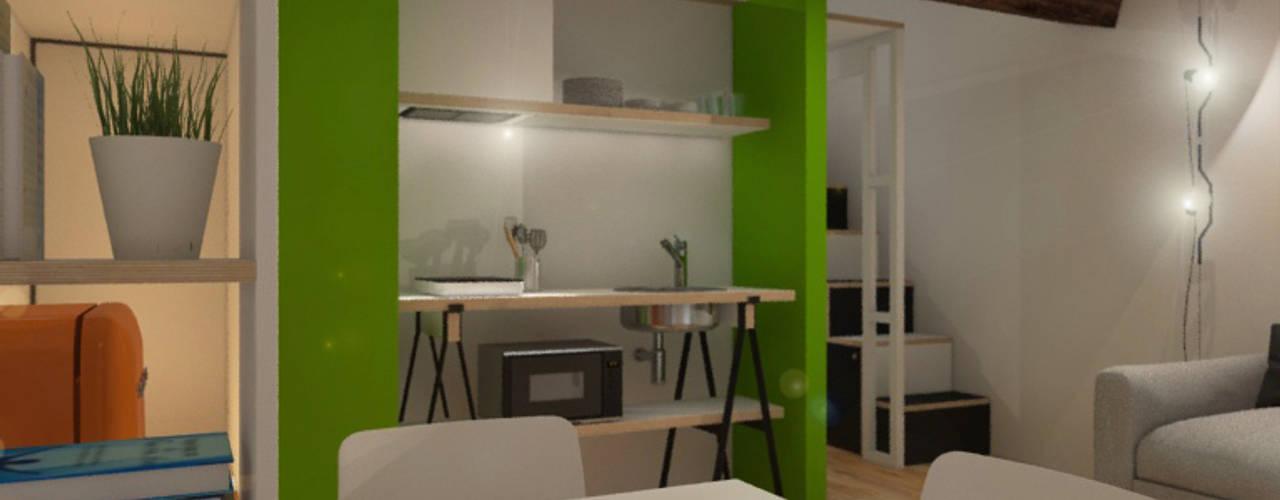 Sottotetto in montagna Sala da pranzo moderna di ibedi laboratorio di architettura Moderno