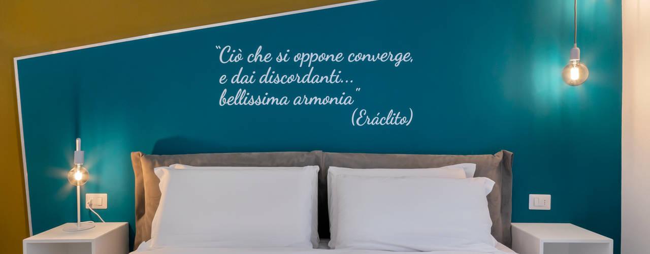 ARCHÈ DI VIA ERACLITO Camera da letto moderna di antonio felicetti architettura & interior design Moderno