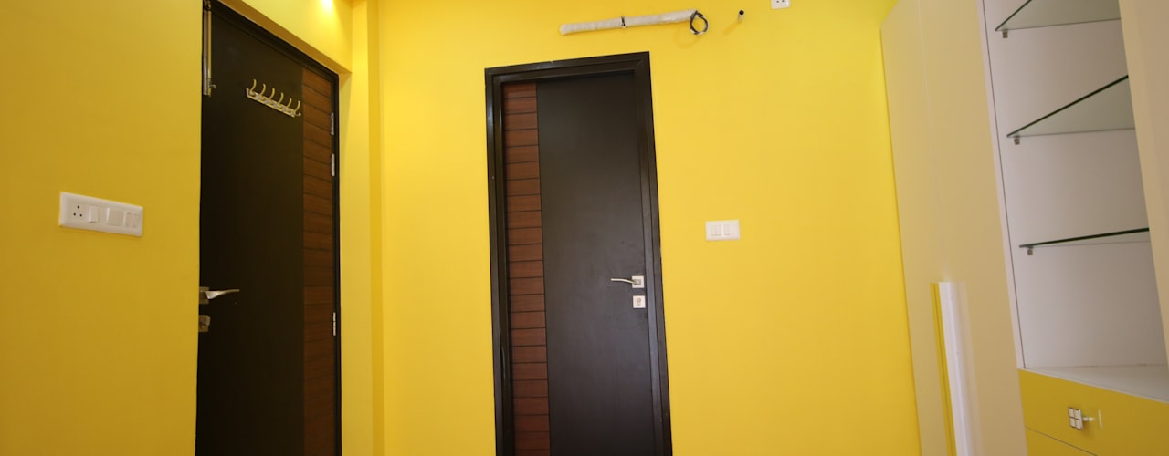 Enrich Interiors & Decors Modern style bedroom Yellow