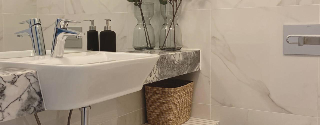Apartamento Lisboa V2E A78 Interiors Casas de banho minimalistas