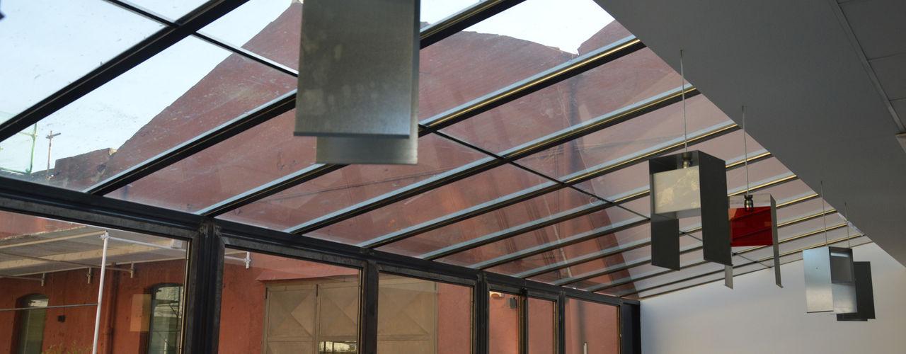 UFFICI, STUDIO PROFESSIONALE E SOCIAL-HOUSE DA RECUPERO INDUSTRIALE Studio Arkilab - Seby Costanzo Centro congressi in stile industrial