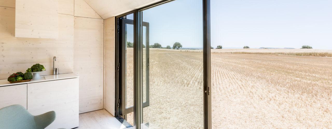 CASA TRANSPORTABLE ÁPH80 ÁBATON Arquitectura Country style windows & doors