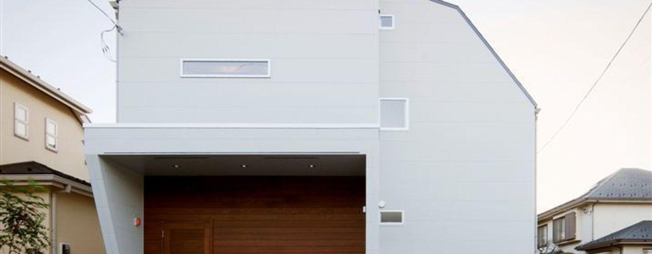 趣味の地下空間をもつコートハウス 充総合計画 一級建築士事務所 モダンな 家
