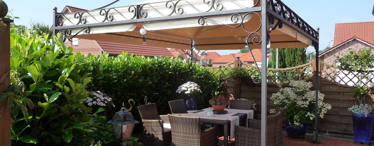 Holz-Wohn-Bau GmbH - kuheiga.com JardinesPérgolas e invernaderos