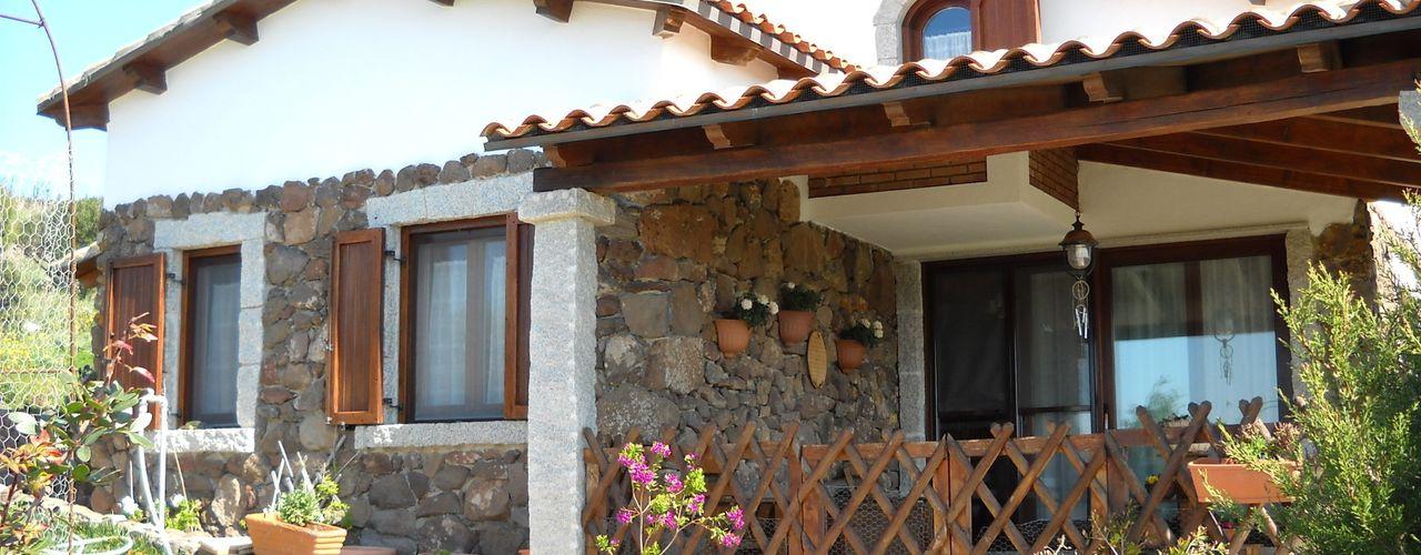 SOGEDI costruzioni Casas de estilo rústico