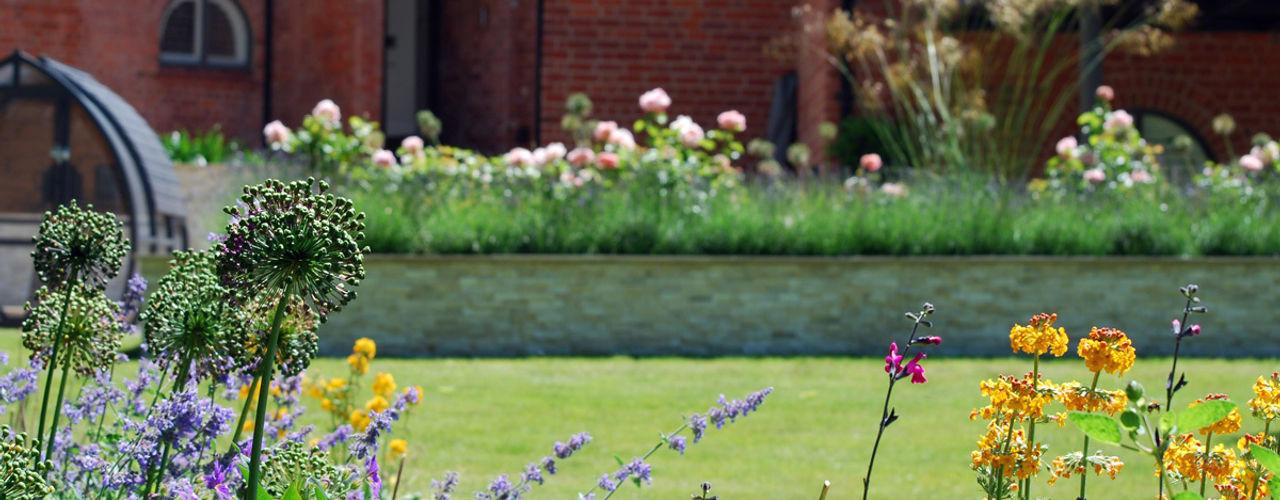 Lawn and planting Lush Garden Design Modern Garden