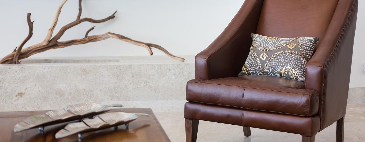 Dovela Interiorismo Living roomSofas & armchairs جلد Brown