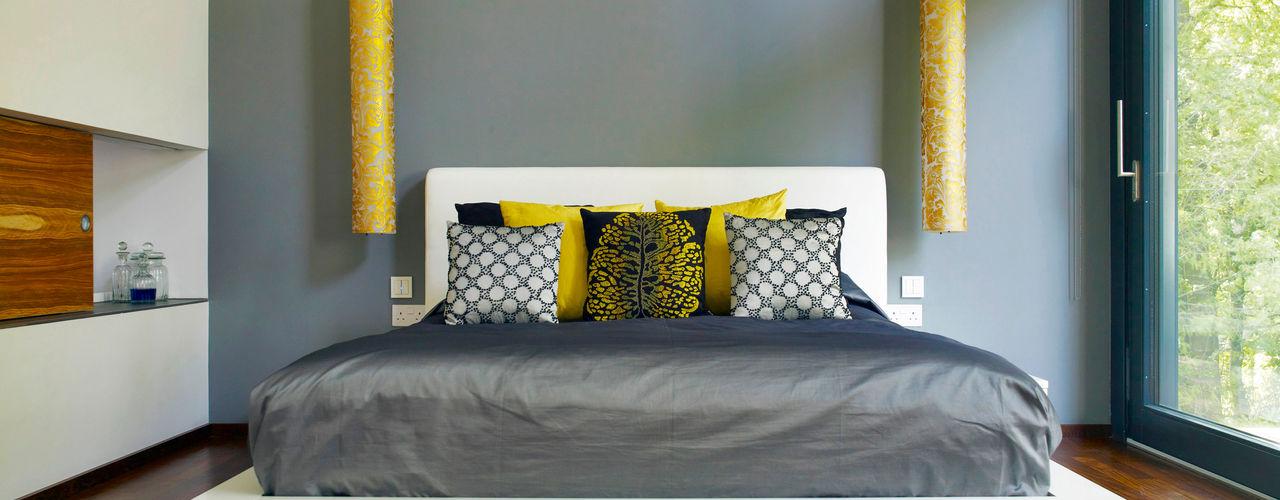 Luxury design house with Balinese flair Baufritz (UK) Ltd. Modern style bedroom