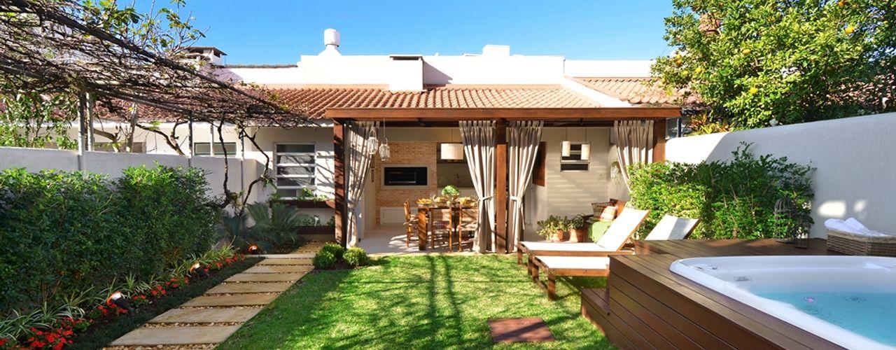 Stefani Arquitetura Jardines de estilo rústico Piedra Verde