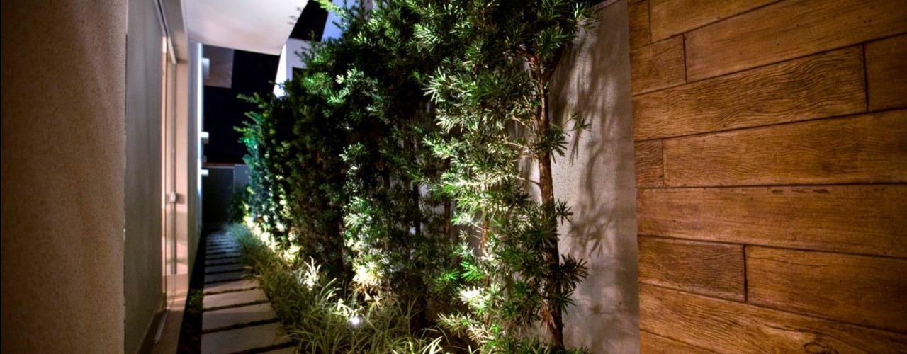 Residência Copacabana Arquitetura Ao Cubo LTDA Jardins tropicais