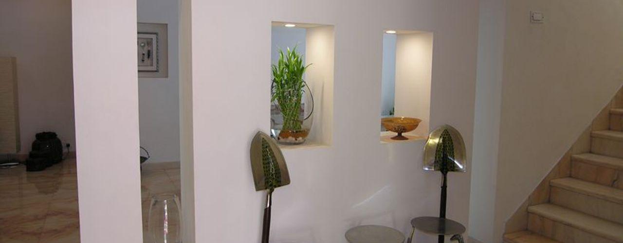 Ansari Architects Salas de estilo moderno