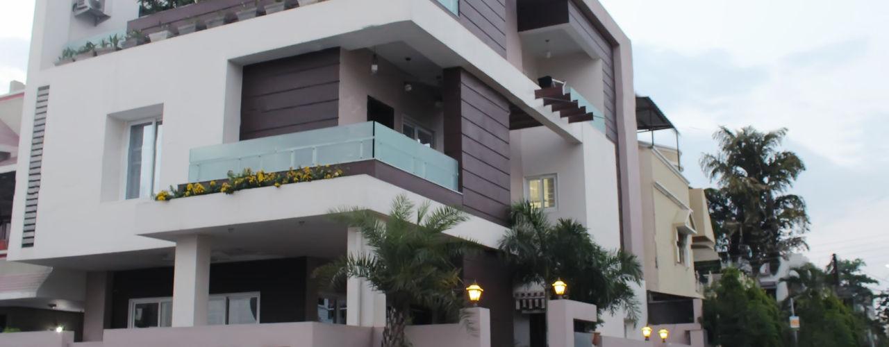 Shadab Anwari & Associates. Asian style houses