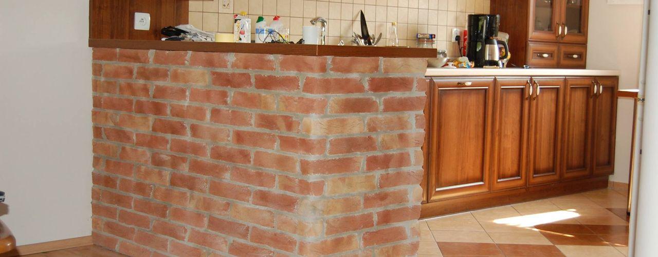 ITA Poland s.c. Cocinas de estilo rústico Ladrillos