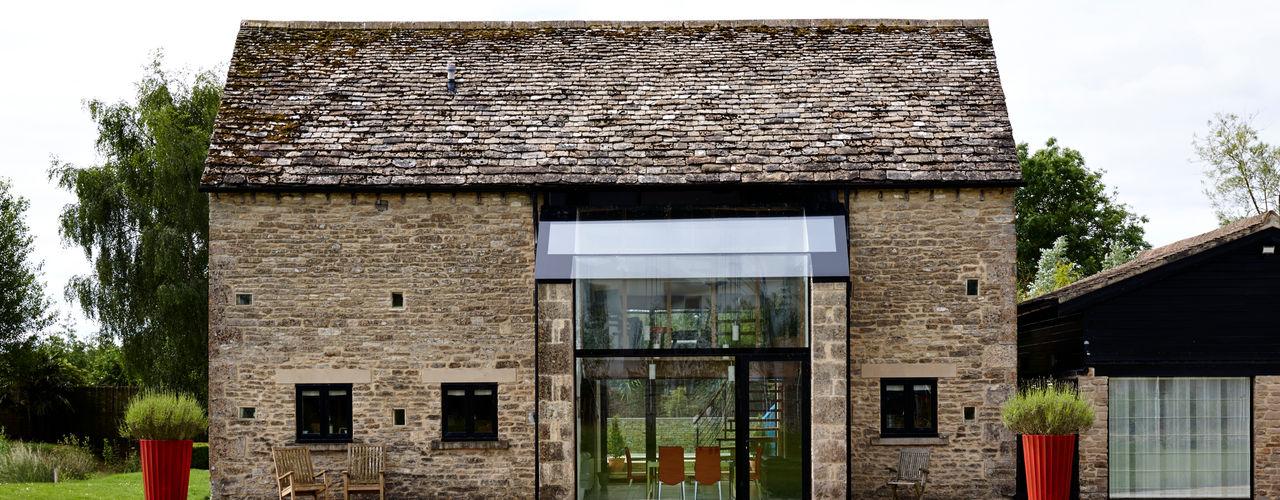 Structural Glazed Screen designed by Trombe Trombe Ltd Finestre & Porte in stile moderno