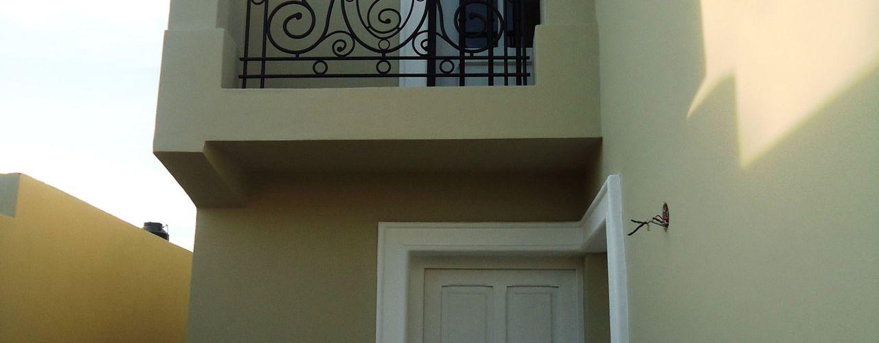 Valy Casas de estilo clásico Ladrillos Verde