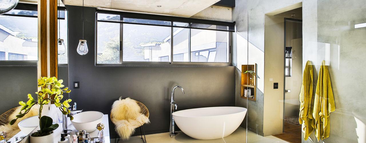 homify Modern bathroom Concrete Grey