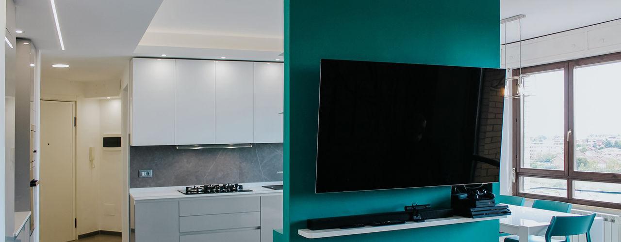CASA VIALE PIERLUIGI NERVI piùottosei architettura Pareti & Pavimenti in stile moderno Cemento Turchese