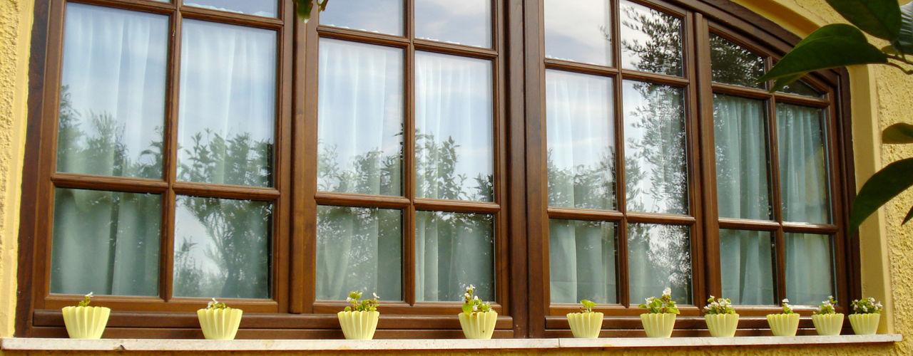 AGRITURISMO LA CIPRIANA CASTAGNETO CARDUCCI LA BERGAMASCA FALEGNAMERIA Finestre in legno Legno Effetto legno
