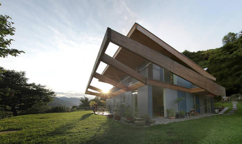 Casa Locarno // Sonnevilla Mediterrane Häuser von designyougo - architects and designers Mediterran Holz Holznachbildung