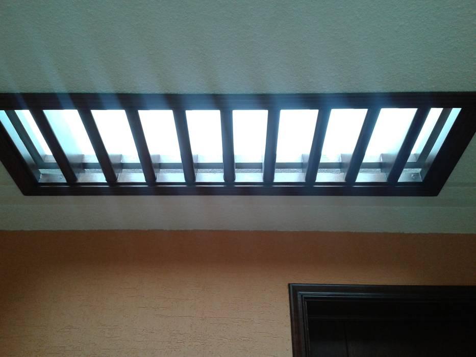 Tronera de luz Casas rústicas de DD Arquitectos Rústico