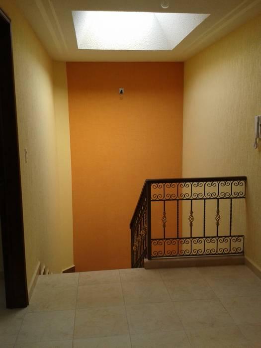 Escaleras Casas rústicas de DD Arquitectos Rústico