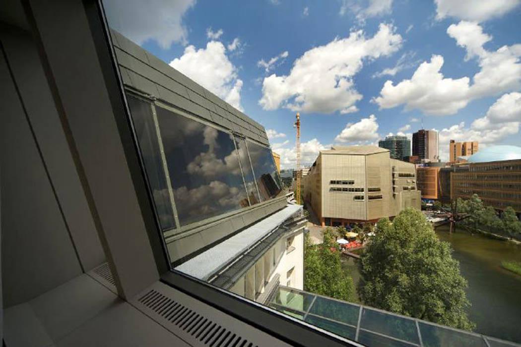 Fassade:  Geschäftsräume & Stores von a-base I büro für architektur