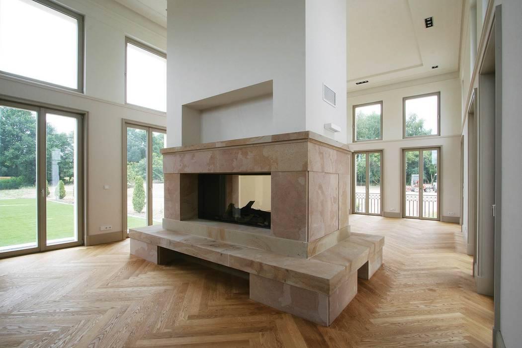 Bellevue zum Schloss - Villa mit Seitenflügeln und Hof:  Wohnzimmer von CG VOGEL ARCHITEKTEN