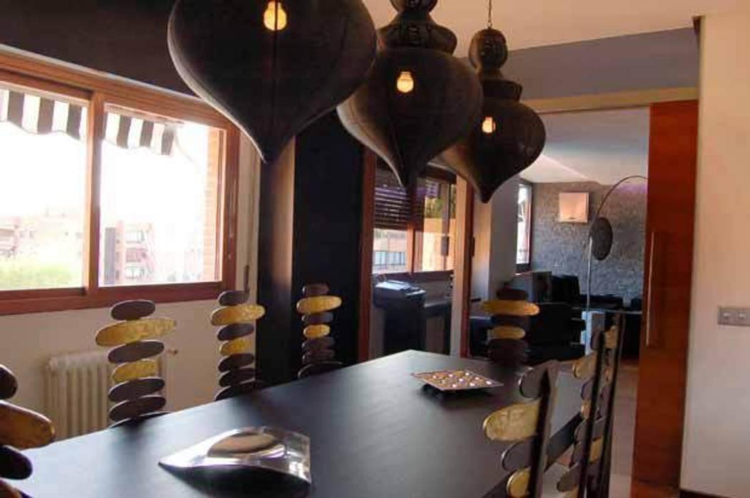 Modern Dining Room by FrAncisco SilvÁn - Arquitectura de Interior Modern
