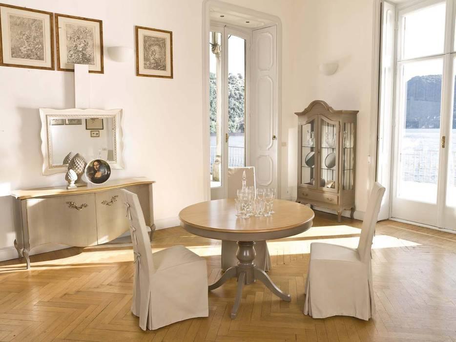 Zona de comedor con mesa redonda.: Salones de estilo  de MUMARQ ARQUITECTURA E INTERIORISMO