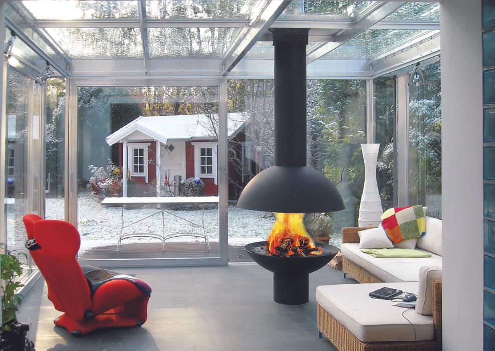 Mezzofocus Fire homify Living roomFireplaces & accessories