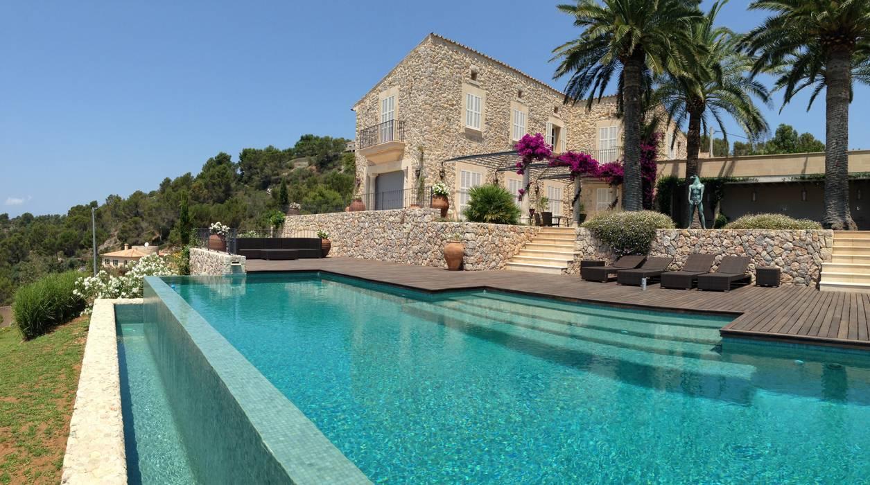 Rumah oleh Fincas Cassiopea Group / FCG Architects , Mediteran