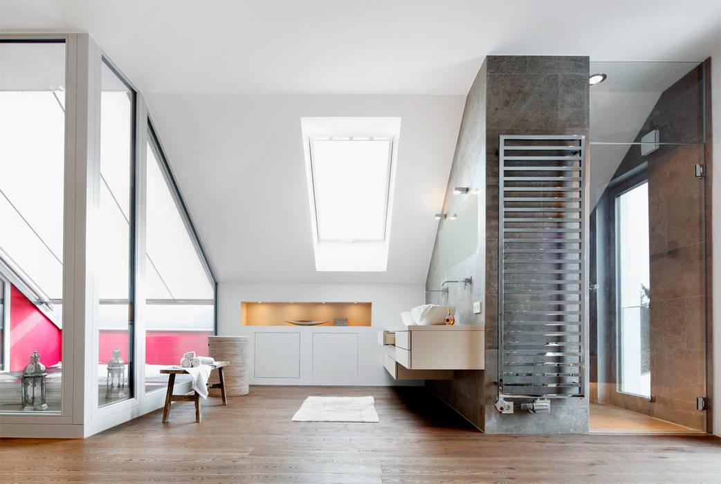 Dachaufstockung eines Einfamilienhauses:  Badezimmer von WSM ARCHITEKTEN