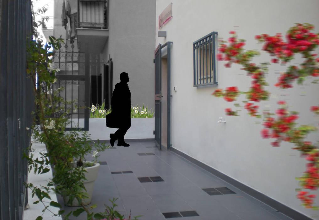 _Fotomontaggio_cortile Case moderne di Idealarchitecture Moderno