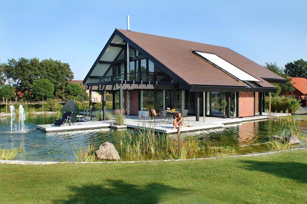 Modernes Holzhaus in Hannover Moderner Garten von DAVINCI HAUS GmbH & Co. KG Modern