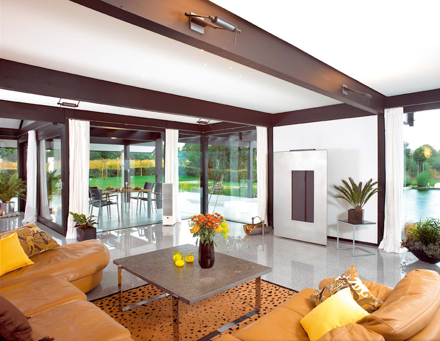 Modernes Holzhaus in Hannover: moderne Wohnzimmer von DAVINCI HAUS GmbH & Co. KG