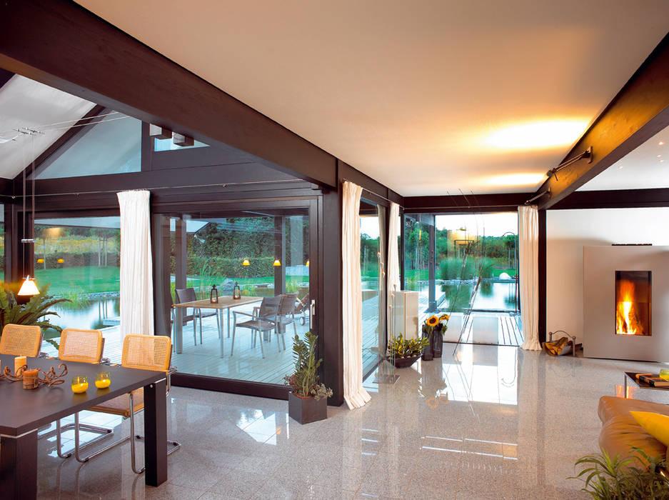 Modernes Holzhaus in Hannover Moderne Esszimmer von DAVINCI HAUS GmbH & Co. KG Modern
