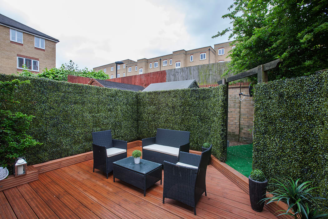 Garden by Millennium Interior Designers,