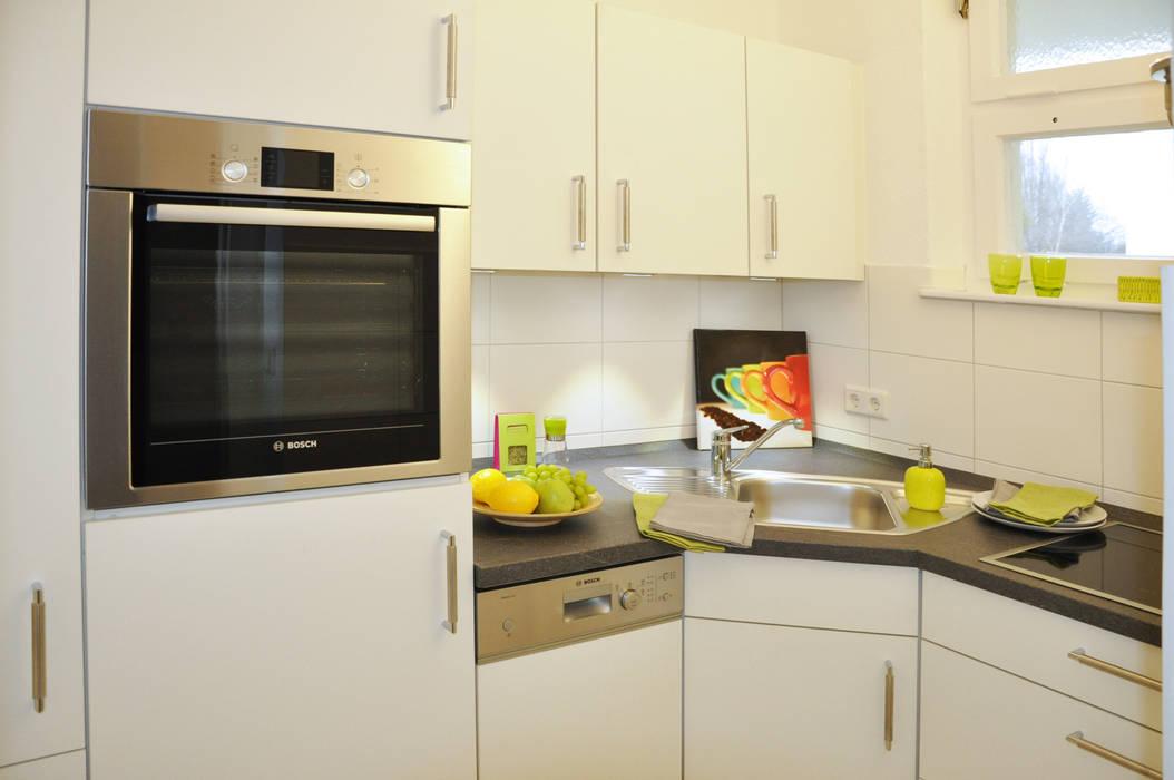 Küche nach dem Home Staging: moderne Wohnzimmer von Optimmo Home Staging