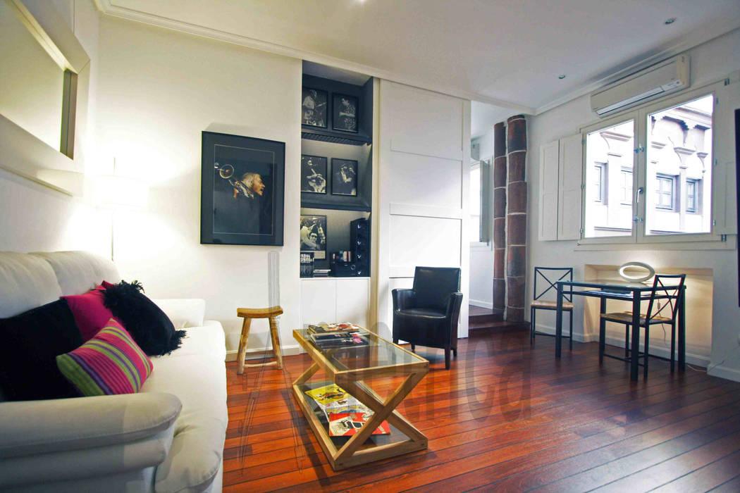 Vista de salón a Dormitorio: Salones de estilo  de Ametrica & Interior, S.L.