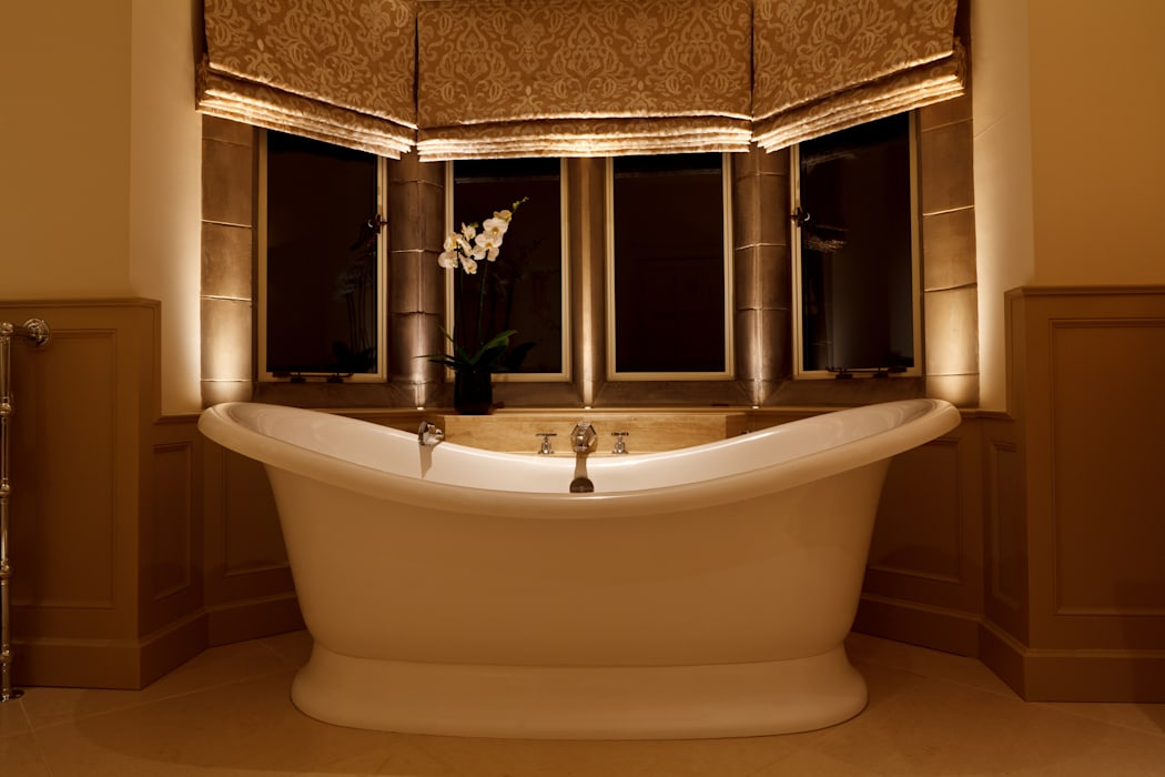 Bay window bath framed with LED uplighters: eclectic Bathroom by Brilliant Lighting