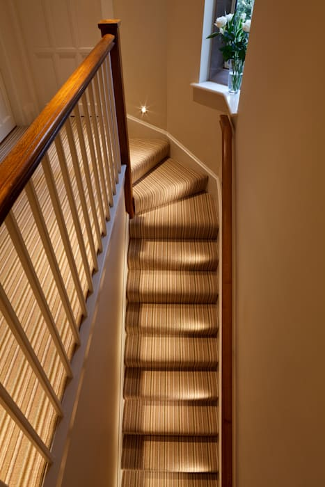 LED lighting on the stairs Eclectic style corridor, hallway & stairs by Brilliant Lighting Eclectic
