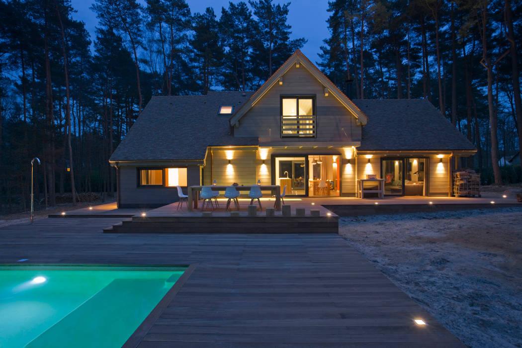 Maison ossature bois: Maisons de style  par blackStones,