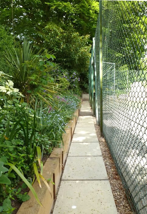 Landscaping around the Tennis Court - Paving & Earth Bank Retention:  Garden by Paul D'Amico Remodels