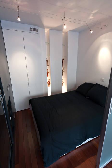 Espace de couchage indépendant dans un studio: Salon de style  par Fables de murs