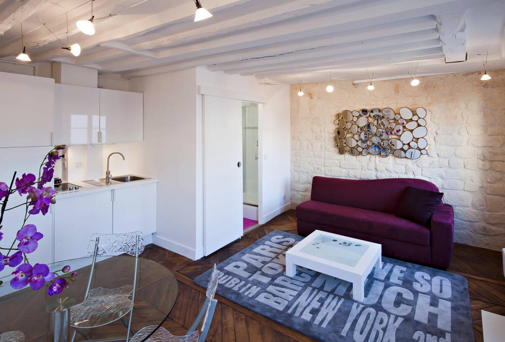 Salon, salle à manger et petite cuisine: Salle à manger de style  par Fables de murs