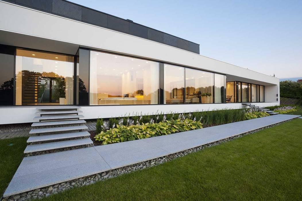 Modern houses by MOBIUS ARCHITEKCI PRZEMEK OLCZYK Modern
