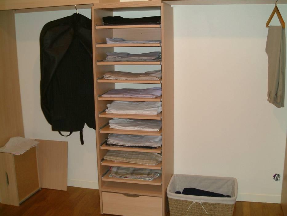 Suite parentale: dressing Dressing moderne par DK2DECO Moderne