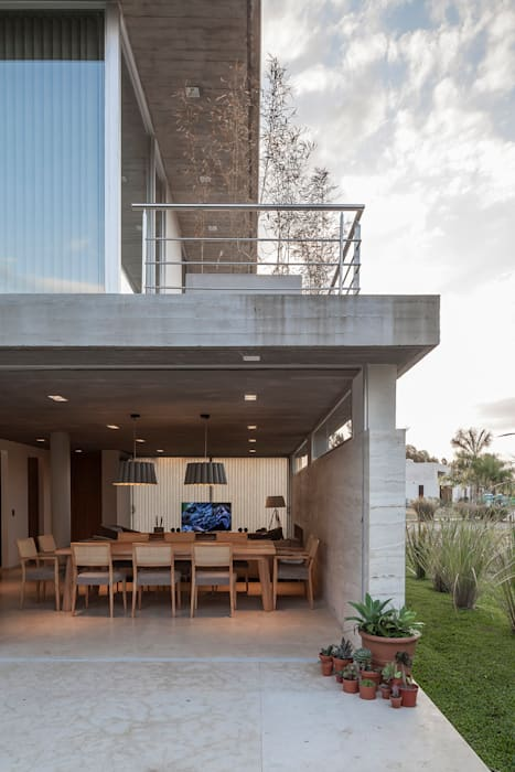 Houses by ESTUDIO GEYA, Modern