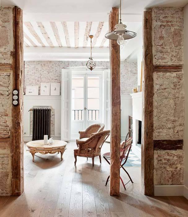 Reforma integral de vivienda: Salones de estilo clásico de Simetrika