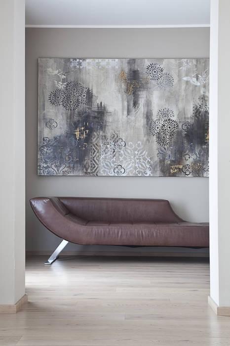 L'ingresso Ingresso, Corridoio & Scale in stile moderno di STUDIO PAOLA FAVRETTO SAGL - INTERIOR DESIGNER Moderno Legno Effetto legno